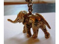 9ct Gold Elephant on a chain in total 54 grams