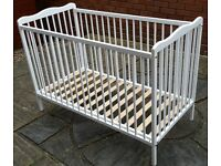 cot bed. white. adjustable base height. In very good condition.