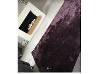 Good size purple plush rug