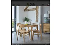 New boxed Oak Furniture Land dinner table for 4