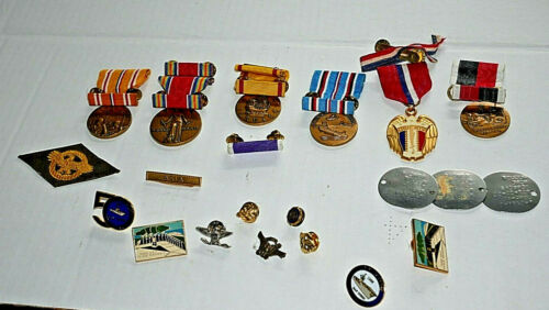 Lot of WWII Asian Theater medals and ribbons with other assorted pinbacks