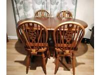 Oak dining table and 4 wheel back chairs