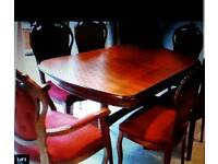 Solid wood extending dining room table & 6 matching chairs - 2 carvers