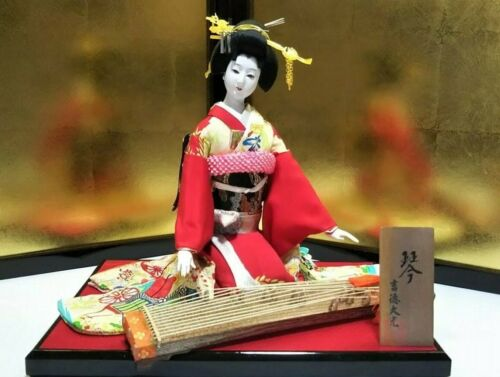 Vintage Japanese doll in Kimono on Wooden Base playing Koto Instrument
