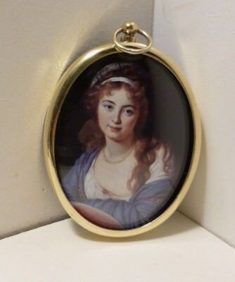 Miniature of country girl with hair band in an oval brass bezel