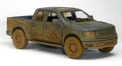 2013 FORD Raptor F-150 SVT Modellauto blau Muddy-Design 1:46 SuperCrew Kinsmart (Ford F150 Raptor)