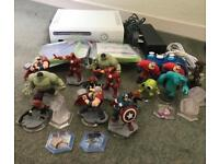 Xbox 360 console with Disney infinity games and figures