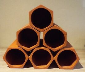 Terracotta wine rack, consisting of 6 individual hexagons