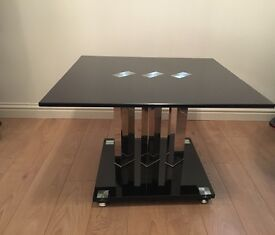 Black glass corner table with chrome pillars