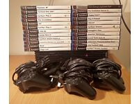 PlayStation 2 Console (PS2) + 24 games + guitar