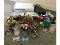 Xbox 360 console and Disney infinity games and figures