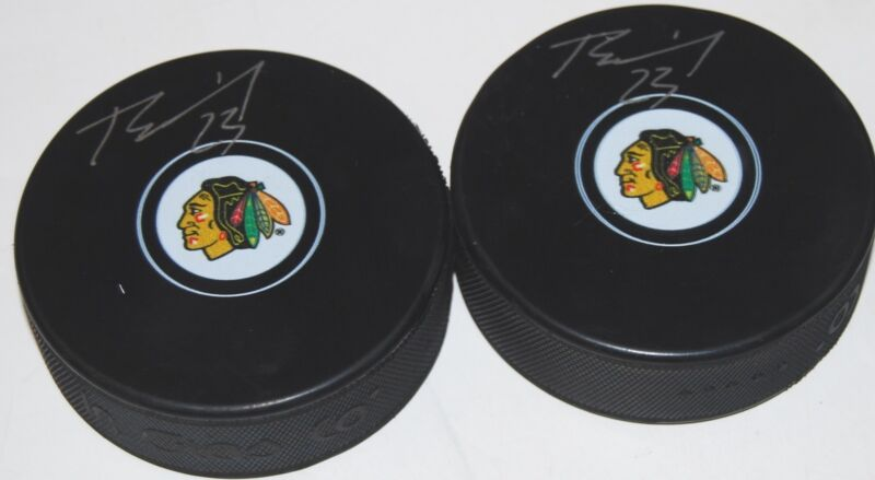 BRANDON MANNING signed (CHICAGO BLACKHAWKS) souvenir logo hockey puck W/COA