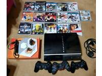 PlayStation 3 with 3 controllers 17 games plus extra
