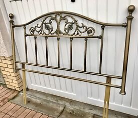 Antique brass effect headboard for a king size bed