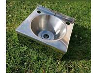 Stainless steel sink with waste