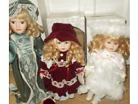 3 boxed Porcelain dolls with stands Leonardo collection