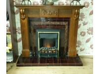 Stunning tiled fireplace with wooden surround and electric fire