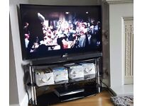 Used black glass TV stand - excellent condition