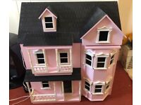 Pink Wooden Doll House with furniture and lighting and 4 dolls
