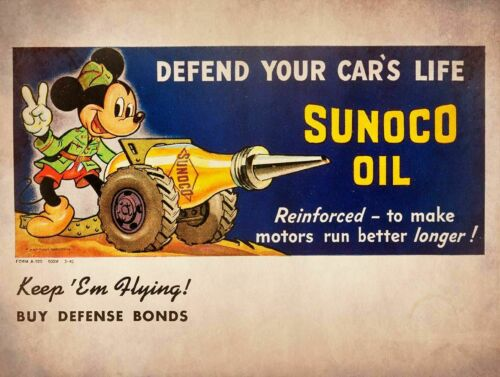 MICKEY MOUSE CANNON SUNOCO MOTOR OIL HEAVY DUTY USA MADE METAL ADVERTISING SIGN