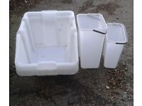 storage tubs & an old buggy for a dog !