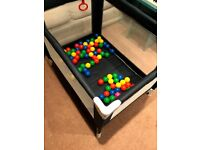 Travel Cot / Play Pen. Fold up, with play balls