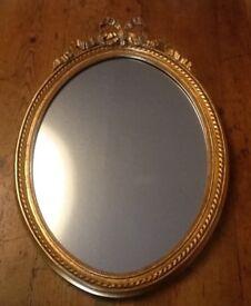 Decorative gilded oval mirror