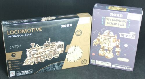 (2) Rokr 3D Puzzle Lot - AM601 Orpheus Steampunk Music Box & LK701 Locomotive