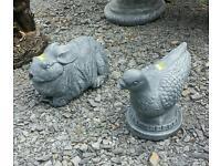 Concrete pigeon and rabbit garden ornament