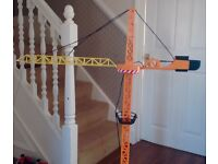 JBC toy crane the arm rotates and hook goes up and down from a wired remote control.