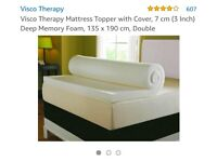 New and unused mattress topper