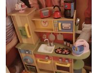 Childrens little tikes wooden kitchen and additional accessories including kettle toastee food etc
