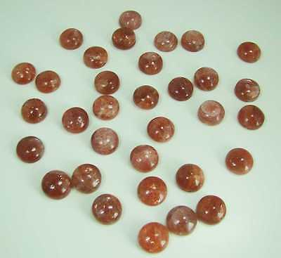 33 Sonnenstein Cabochons // d= ca. 15 mm  -  ca. 390 Carat