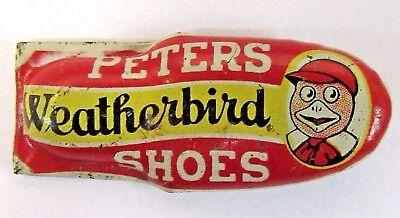 1930's PETERS WEATHERBIRD SHOES yellow advertising tin clicker premium w/ MASCOT