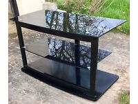 Black glass TV stand, 3 shelved unit - in great condition. £22 ONO.