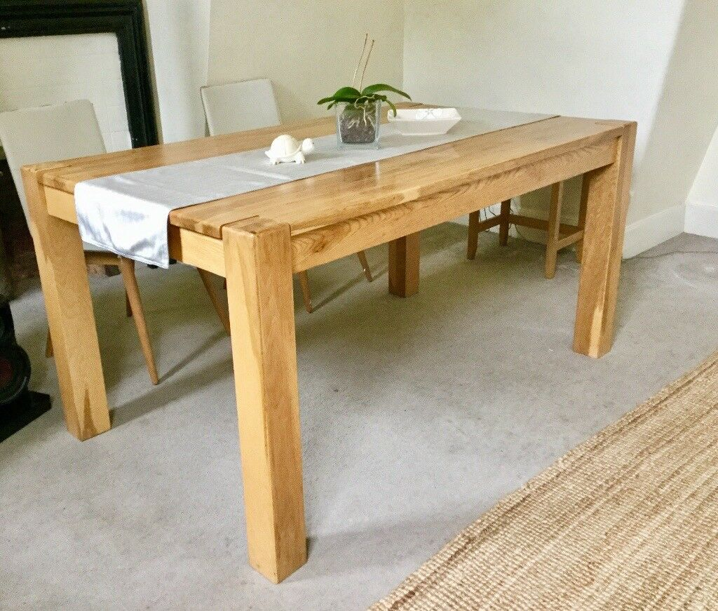 Ontario solid oak wood dining table by debenhams