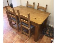 Solid wood dining table and four chairs for sale