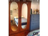 Beautiful wooden wardrobe with mirrors