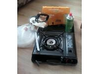 Camping stove 5 New has cartridges kettle and water carrier