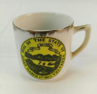 "Lincoln Nebraska State Seal Tea Cup Souvenir Gold/Gilt Rim ~2"" tall vintage shot"