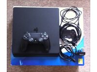 PS4 Slim 500GB + 2 games - In as new condition