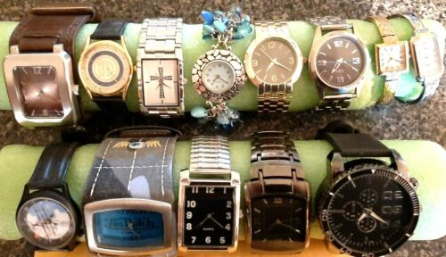 Lot of 13 mens and womens watches. All run,all with new batterys,keepinggoodtime