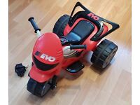 Toddler motorized trike Evo. Red/black. suit age 18m- 3yr. Plug in to charge.