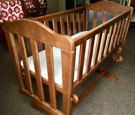 Baby's rocking crib dark wood