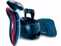 Philips SensoTouch RQ1180cc GyroFlex 2D with cleaning base PLUS Philips OneBlade Shaver