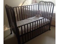 Mahogany Drop Side Cot Bed for £20.00 in SE22