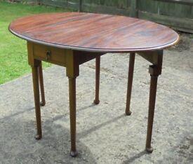 Georgian mahogany drop leaf table.