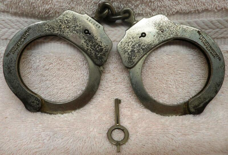 """Vintage Police Handcuffs-""""THE PEERLESS HANDCUFF CO."""" Cuffs w/1 Key Serial 122263"""