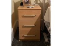 Light wood bed side chest of draws