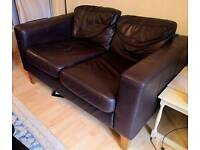Two brown leather two seater sofas